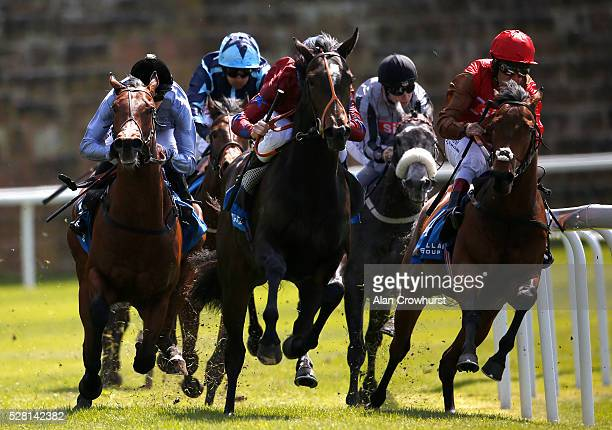 James Doyle riding Copper Knight turn into the straight to win The Stellar Group Lily Agnes Conditions Stakes at Chester racecourse on May 4 2016 in...