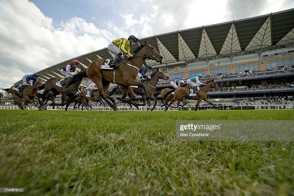 James Doyle riding Lilyfire (R) win The John Guest EBF Maiden Fillies' Stakesat Ascot racecourse on July 26, 2013 in Ascot, England.