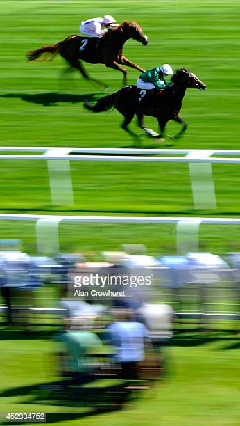 James Doyle riding Limato win The Rose Bowl Stakes at Newbury racecourse on July 18 2014 in Newbury England