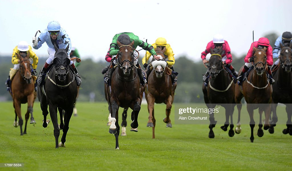 James Doyle riding Nine Realms (green) win The Les Ambassadeurs Casino Shergar Cup Mile at Ascot racecourse on August 10, 2013 in Ascot, England.