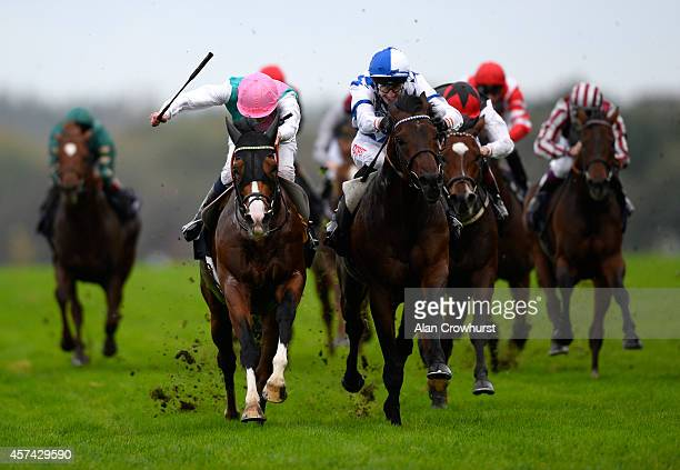 James Doyle riding Noble Mission win The Qipco Champions Stakes from Al Kazeem at Ascot racecourse on October 18 2014 in Ascot England