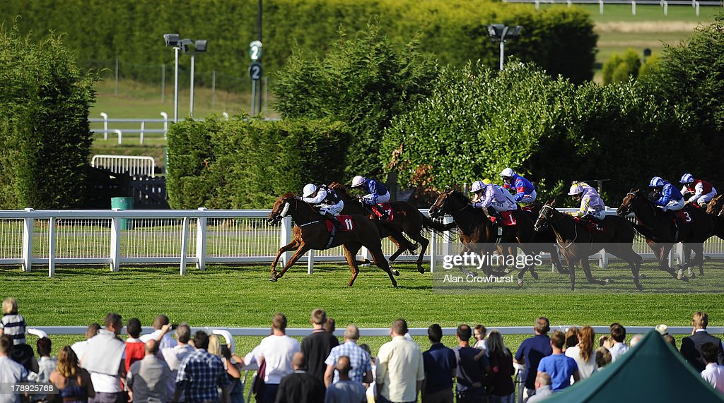 James Doyle riding Rainbow Beauty (L) win The Betfred Double Delight/Hat Trick Heaven Handicap Stakes at Sandown racecourse on August 31, 2013 in Esher, England.