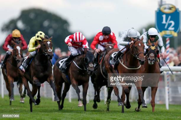 James Doyle riding Threading win The Sky Bet Lowther Stakes at York racecourse on August 24 2017 in York England
