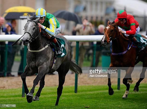 James Doyle riding Winning Express win The EBF Stallions/Arkle Finance Eternal Stakes at Warwick racecourse on June 27 2013 in Warwick England