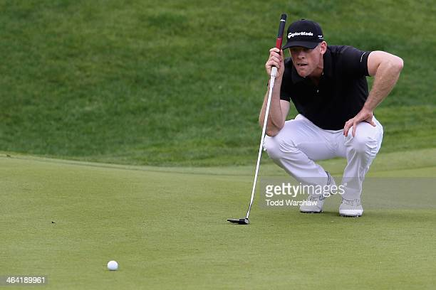 James Driscoll assesses a putt on the 16th green during the final round of the Humana Challenge in partnership with the Clinton Foundation on the...