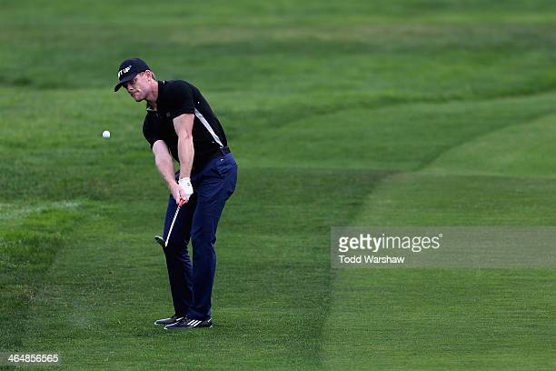 James Driscoll hits a shot on the first hole during the second round of the Farmers Insurance Open on Torrey Pines South on January 24 2014 in La...