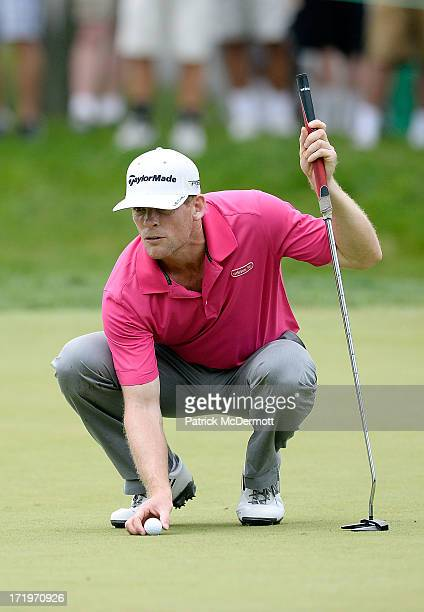 James Driscoll lines up a putt on the first green during the final round of the ATT National at Congressional Country Club on June 30 2013 in...
