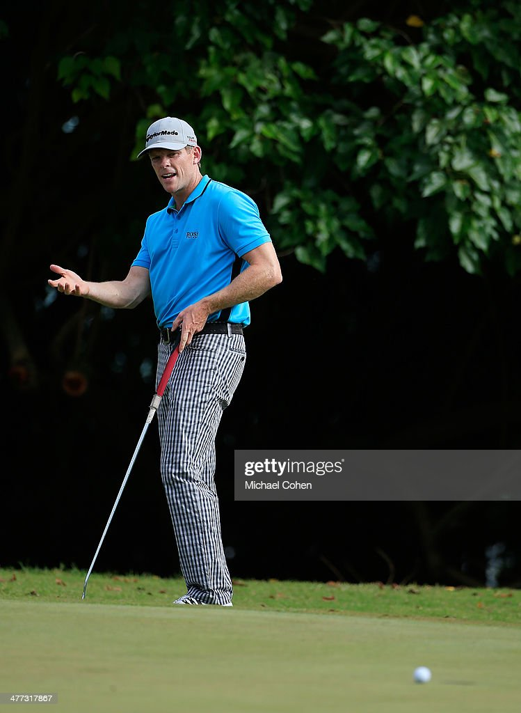<a gi-track='captionPersonalityLinkClicked' href=/galleries/search?phrase=James+Driscoll&family=editorial&specificpeople=818192 ng-click='$event.stopPropagation()'>James Driscoll</a> reacts to his missed birdie putt on the 15th green during the third round of the Puerto Rico Open presented by seepuertorico.com held at Trump International Golf Club on March 8, 2014 in Rio Grande, Puerto Rico.