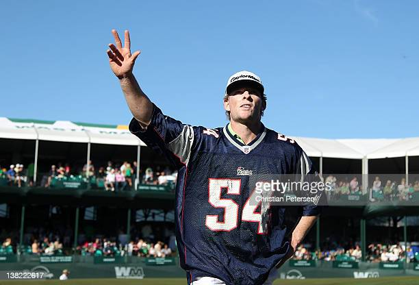 James Driscoll wearing a Tedy Bruschi New England Patriots jersey waves to the fans as he leaves the 16th hole during the third round of the Waste...