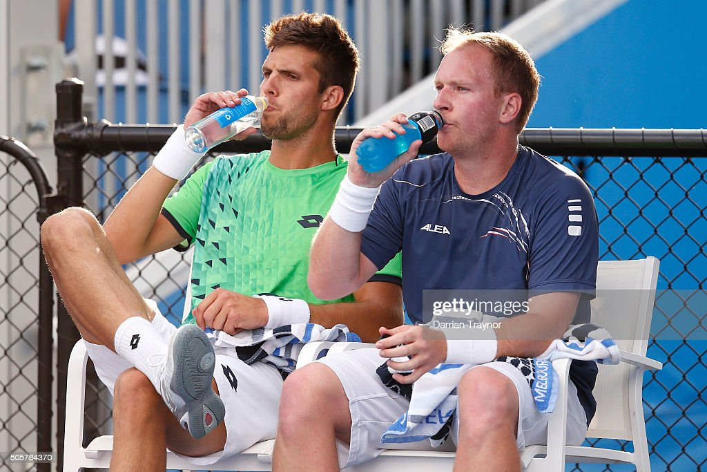 James Duckworth of Australia and John Millman of Australia take a break in their first round match against Lukas Dlouhy of the Czech Republic and...