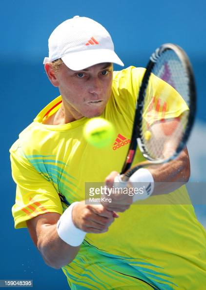 James Duckworth of Australia plays a backhand in his first round match against Denis Istomin of Uzbekistan during day two of the Sydney International...