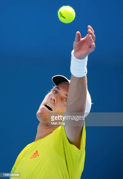 James Duckworth of Australia serves in his first round match against Denis Istomin of Uzbekistan during day two of the Sydney International at Sydney...