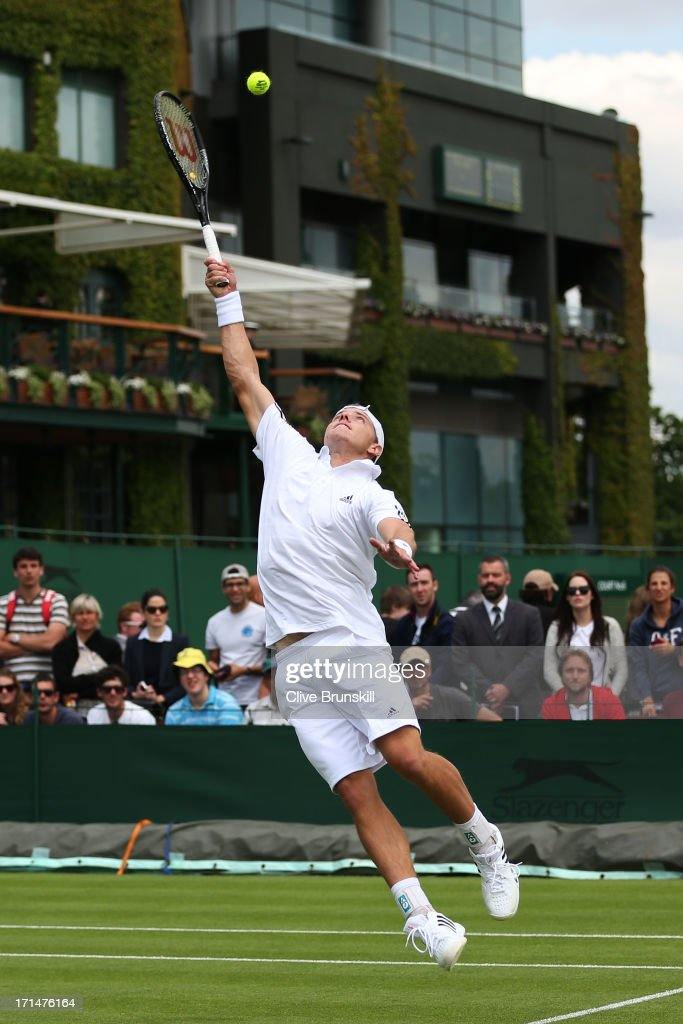James Duckworth of Australia stretches to return a shot during his Gentlemen's Singles first wround match against Denis Kudla of the United States of America on day two of the Wimbledon Lawn Tennis Championships at the All England Lawn Tennis and Croquet Club on June 25, 2013 in London, England.