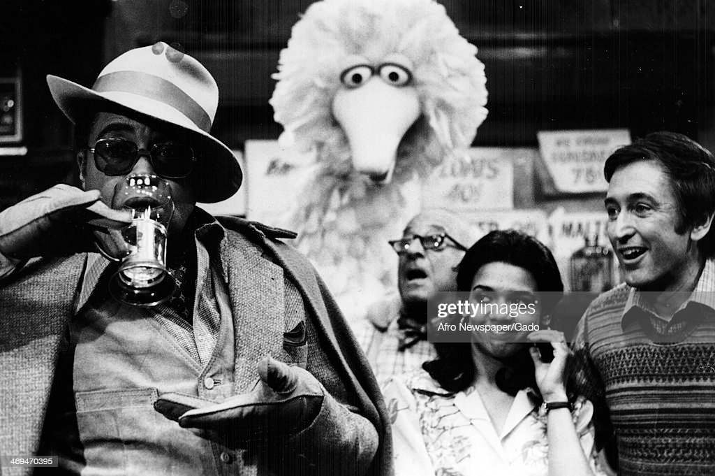 James Earl Jones guest stars on Sesame Street with regular cast members Big Bird, Mr Hooper and Maria to try the perfect egg cream, New York, April 5, 1969.