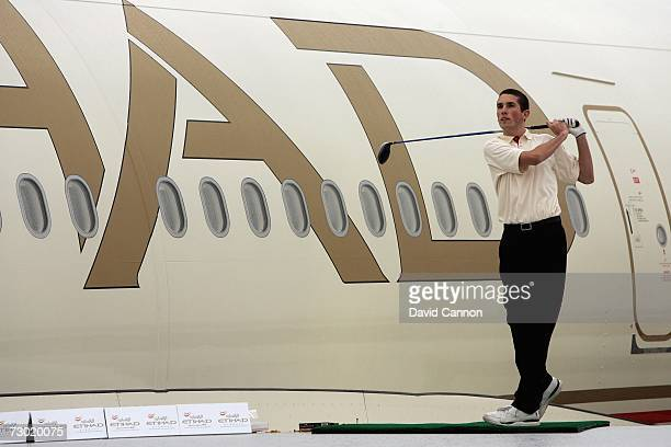 James Efde of the England a Wentworth Golf Club Golf Scholar hits a ball from the wing of an Etihad Airways Airbus A340 during the 'Etihad Airways...