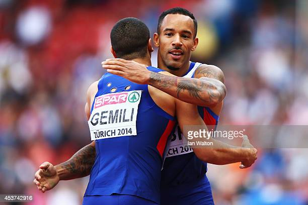 James Ellington and Adam Gemili of Great Britain and Northern Ireland celebrate winning gold after the Men's 4x100 metres relay final during day six...