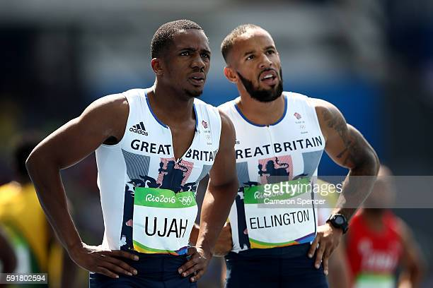 James Ellington and Chijindu Ujah of Great Britain react during round one of the Men's 4 x 100m Relay on Day 13 of the Rio 2016 Olympic Games at the...