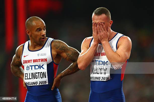James Ellington of Great Britain and Richard Kilty of Great Britain react after failing to finish in the Men's 4x100 Metres Relay final during day...
