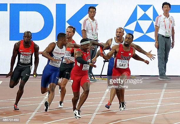 James Ellington of Great Britain and Tyson Gay of the United States change over to Chijindu Ujah of Great Britain and Mike Rodgers of the United...