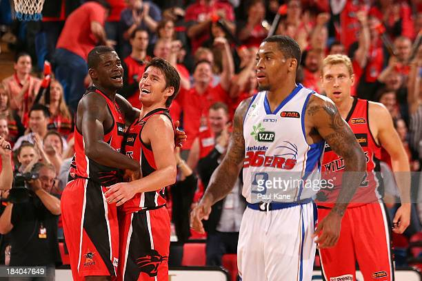 James Ennis and Damian Martin of the Wildcats celebrate winning the round one NBL match between the Perth Wildcats and the Adelaide 36ers at Perth...