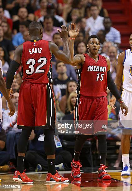 James Ennis and Mario Chalmers of the Miami Heat react to a play during a game against the Golden State Warriors at American Airlines Arena on...
