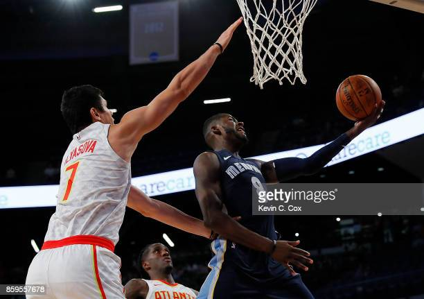 James Ennis III of the Memphis Grizzlies drives against Ersan Ilyasova of the Atlanta Hawks at McCamish Pavilion on October 9 2017 in Atlanta Georgia...