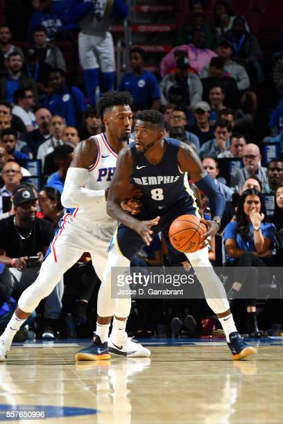 James Ennis III of the Memphis Grizzlies handles the ball against Robert Covington of the Philadelphia 76ers during a preseason game on October 4...