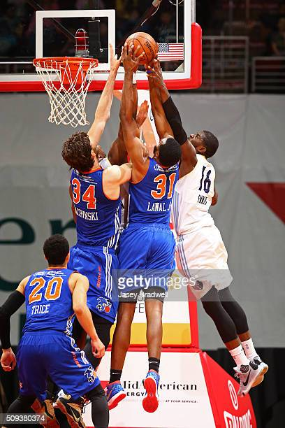 James Ennis of the Iowa Energy goes up for a rebound against Jordan Bachynski and Gani Lawal of the Westchester Knicks in an NBA DLeague game on...