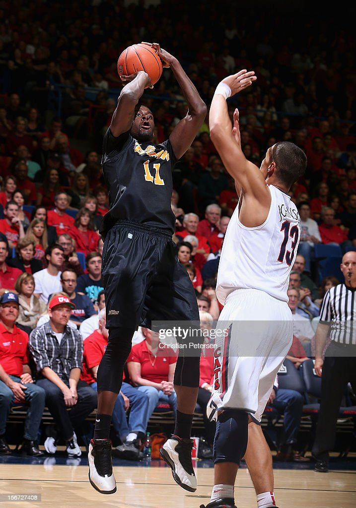 James Ennis #11 of the Long Beach State 49ers puts up a shot over Nick Johnson #13 of the Arizona Wildcats during the first half of the college basketball game at McKale Center on November 19, 2012 in Tucson, Arizona. The Wildcats defeated the 49ers 94-72.
