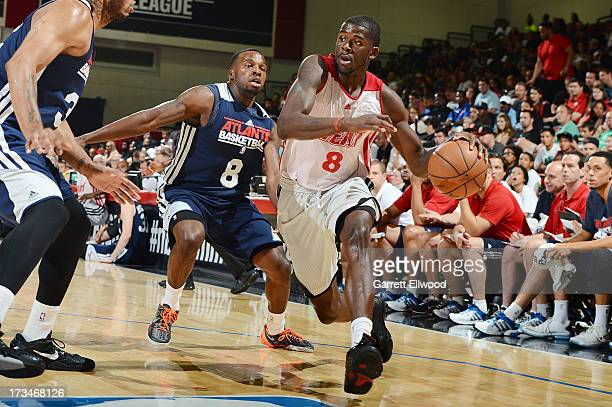 James Ennis of the Miami Heat drives against Shelvin Mack of the Atlanta Hawks during NBA Summer League on July 14 2013 at the Cox Pavilion in Las...