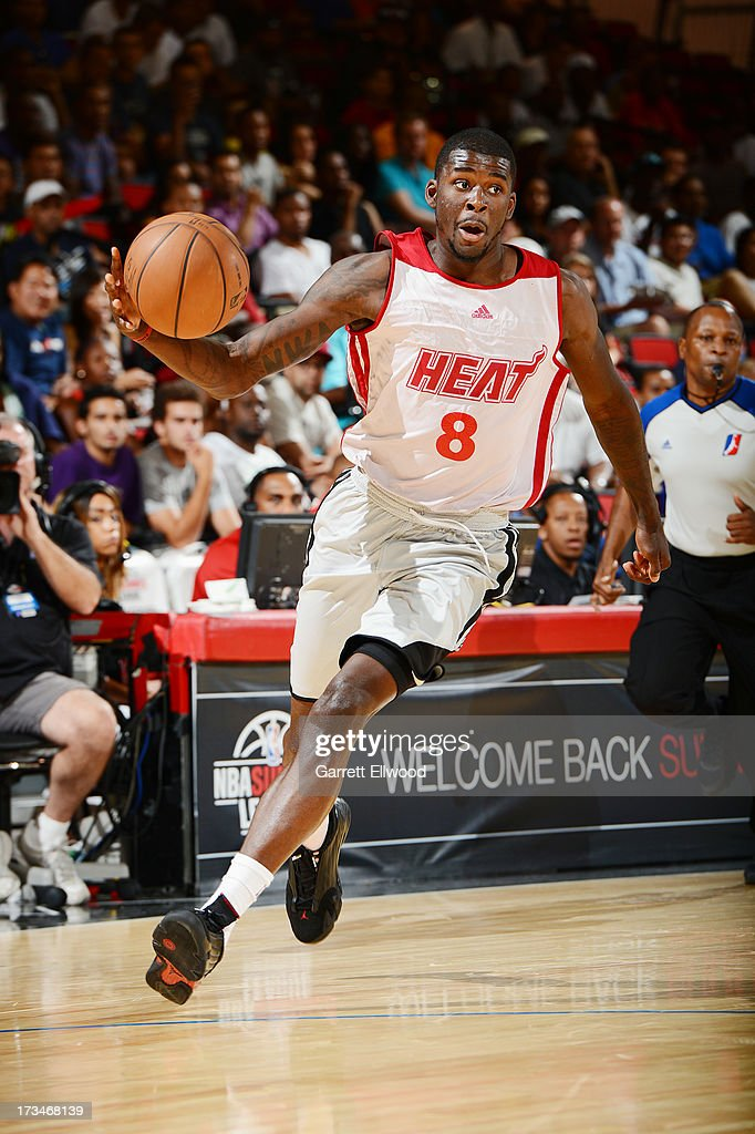 James Ennis #8 of the Miami Heat drives against the Atlanta Hawks during NBA Summer League on July 14, 2013 at the Cox Pavilion in Las Vegas, Nevada.