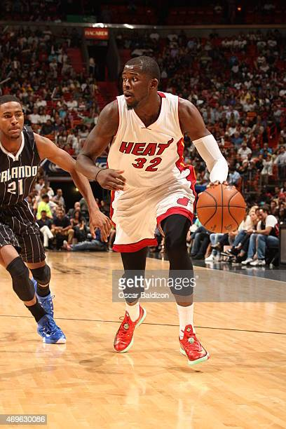 James Ennis of the Miami Heat drives to the basket against Maurice Harkless of the Orlando Magic on April 13 2015 at American Airlines Arena in Miami...