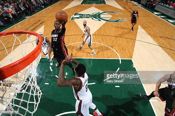 James Ennis of the Miami Heat goes to the basket against Larry Sanders of the Milwaukee Bucks on December 5 2014 at the BMO Harris Bradley Center in...