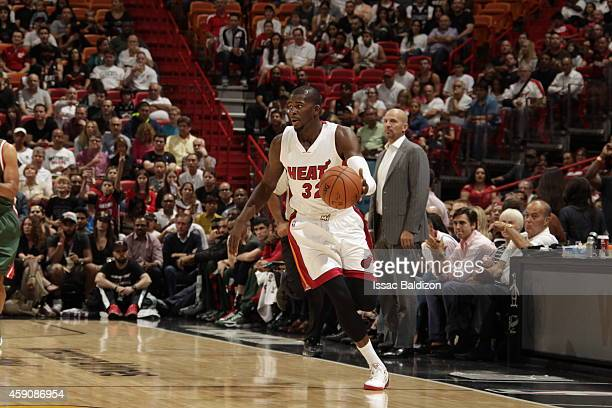 James Ennis of the Miami Heat handles the ball against the Milwaukee Bucks during the game on November 16 2014 at AmericanAirlines Arena in Miami...