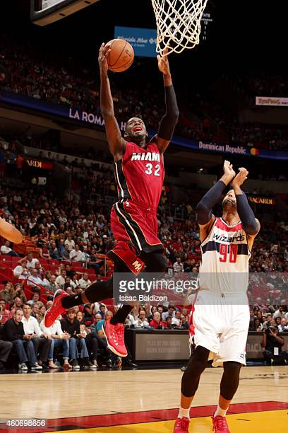 James Ennis of the Miami Heat shoots against the Washington Wizards on December 19 2014 at American Airlines Arena in Miami Florida NOTE TO USER User...
