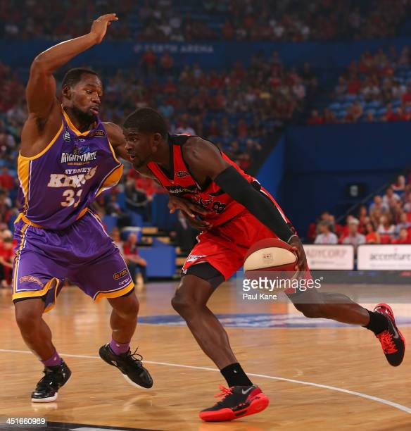 James Ennis of the Wildcats drives to the basket against Sam Young of the Kings during the round seven NBL match between the Perth Wildcats and the...