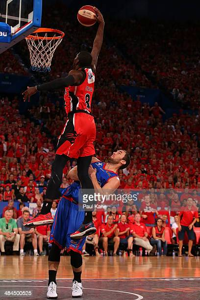 James Ennis of the Wildcats dunks the ball against Adam Gibson of the 36ers during game three of the NBL Grand Final series between the Perth...