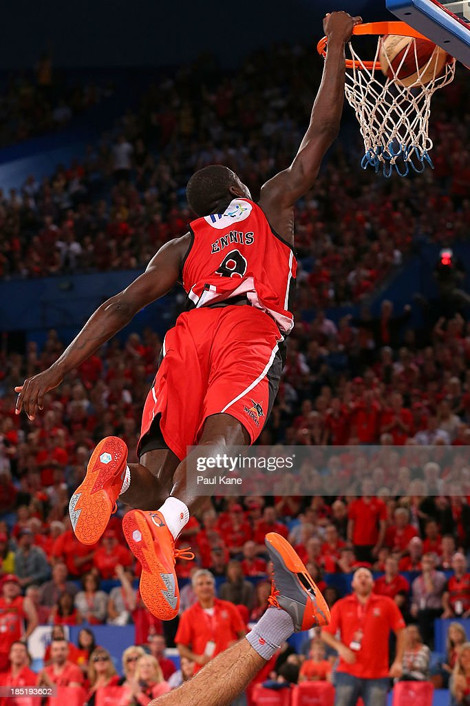James Ennis of the Wildcats dunks the ball during the round two NBL match between the Perth Wildcats and the Sydney Kings at Perth Arena in October 18, 2013 in Perth, Australia.