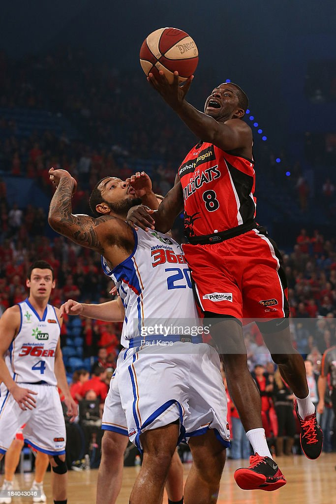 <a gi-track='captionPersonalityLinkClicked' href=/galleries/search?phrase=James+Ennis&family=editorial&specificpeople=8677438 ng-click='$event.stopPropagation()'>James Ennis</a> of the Wildcats lays up against BJ Anthony of the 36ers during the round one NBL match between the Perth Wildcats and the Adelaide 36ers at Perth Arena in October 11, 2013 in Perth, Australia.