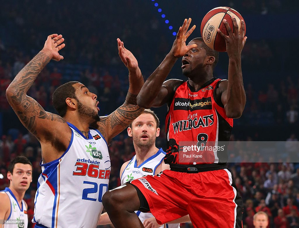 <a gi-track='captionPersonalityLinkClicked' href=/galleries/search?phrase=James+Ennis&family=editorial&specificpeople=8677438 ng-click='$event.stopPropagation()'>James Ennis</a> of the Wildcats lays up during the round one NBL match between the Perth Wildcats and the Adelaide 36ers at Perth Arena in October 11, 2013 in Perth, Australia.