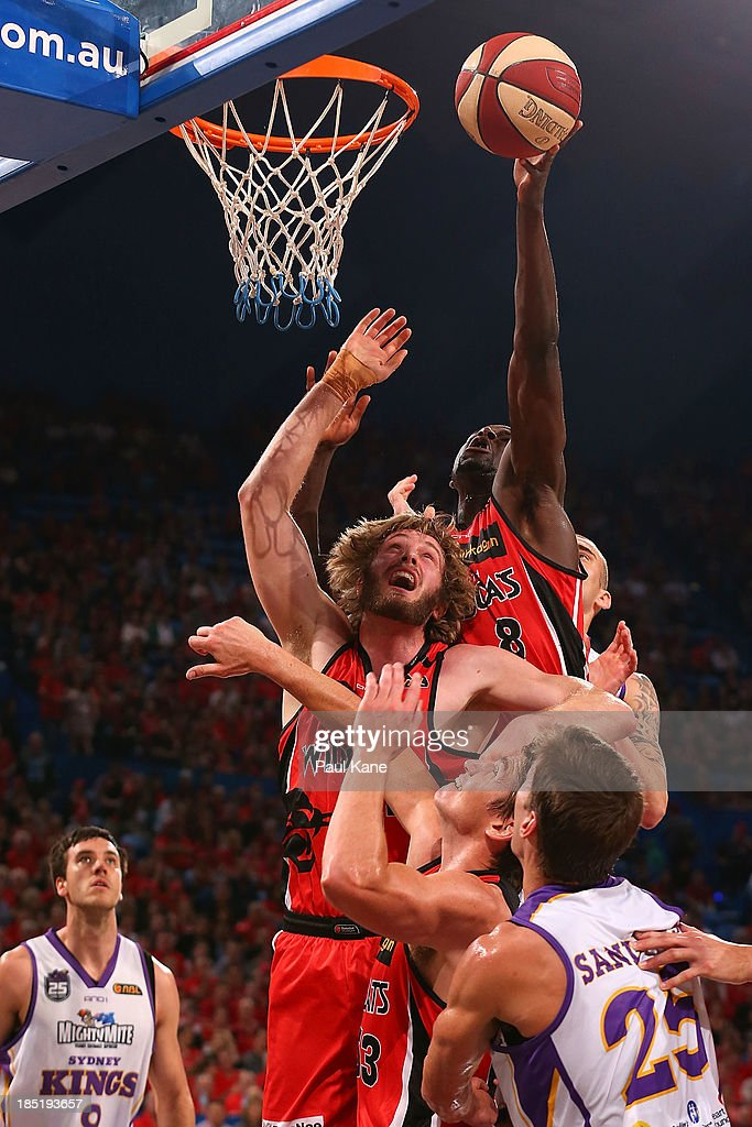James Ennis of the Wildcats rebounds during the round two NBL match between the Perth Wildcats and the Sydney Kings at Perth Arena in October 18, 2013 in Perth, Australia.