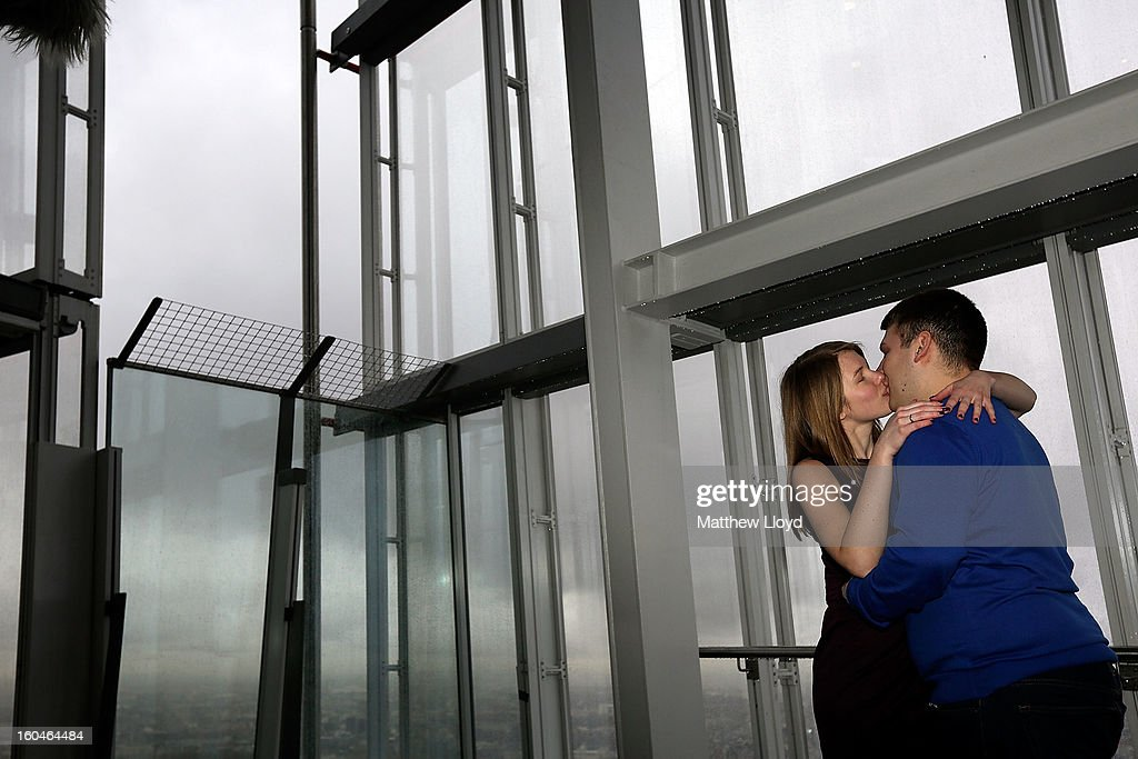 James Episcopou and Laura Taylor kiss after he proposed to her at the View from the Shard on it's opening morning on February 1, 2013 in London, England. Level 72 is the highest viewing gallery in The View from The Shard, and the highest vantage point in Western Europe.