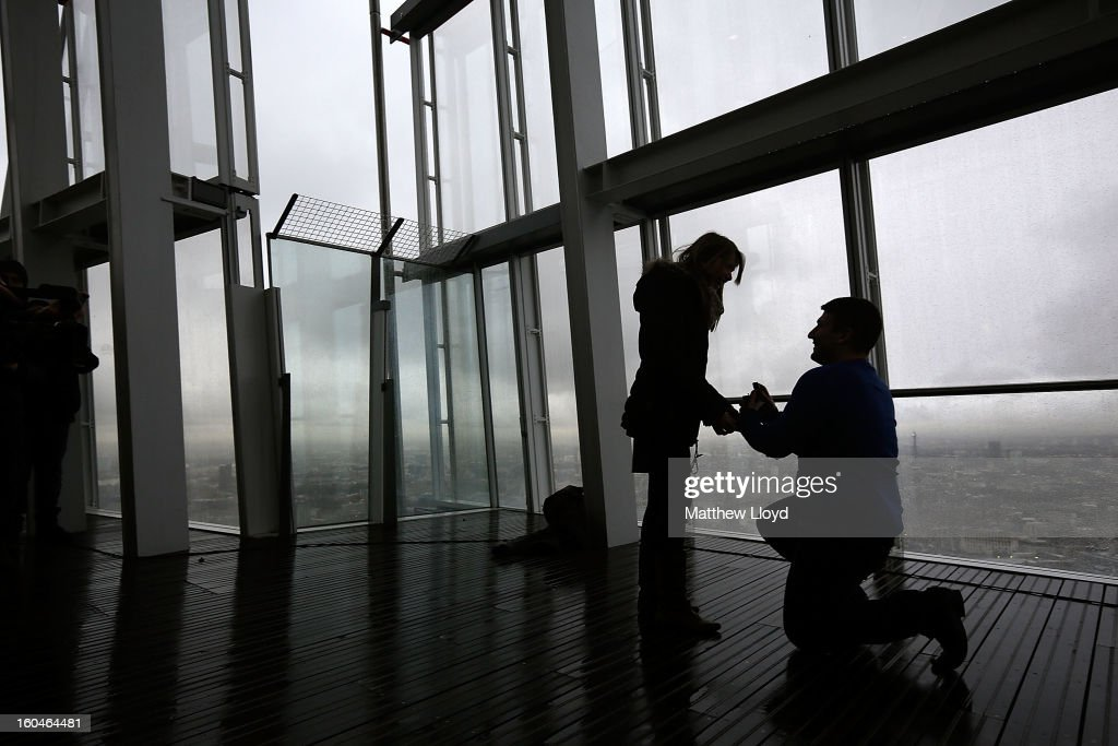 James Episcopou proposes to Laura Taylor at the View from the Shard on it's opening morning on February 1, 2013 in London, England. Level 72 is the highest viewing gallery in The View from The Shard, and the highest vantage point in Western Europe.