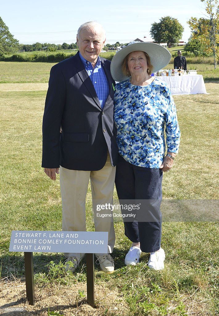 James Comley and Virginia Comley attend the Naming Celebration For Stewart F. Lane & Bonnie Comley Event Lawn at the Parrish Art Museum on August 29, 2014 in Water Mill, New York.