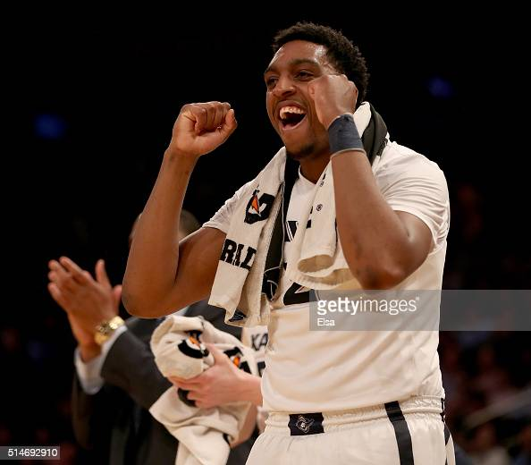 James Farr of the Xavier Musketeers celebrates a teammates basket in the second half against the Marquette Golden Eagles during the quarterfinals of...