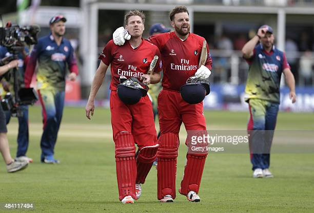 James Faulkner and Arron Lilley of Lancashire walk off after their teams victory in the NatWest T20 Blast quarter final match between Kent Spitfires...