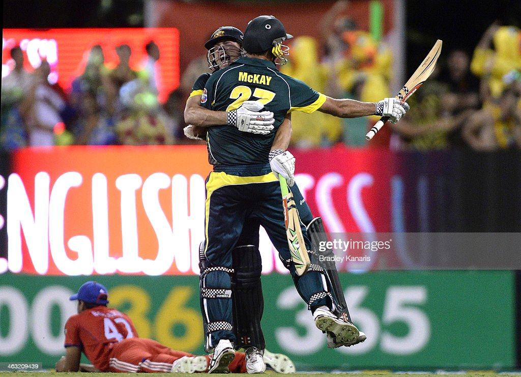 James Faulkner and <a gi-track='captionPersonalityLinkClicked' href=/galleries/search?phrase=Clint+McKay&family=editorial&specificpeople=4083690 ng-click='$event.stopPropagation()'>Clint McKay</a> of Australia celebrate victory after the second game of the One Day International Series between Australia and England at The Gabba on January 17, 2014 in Brisbane, Australia.