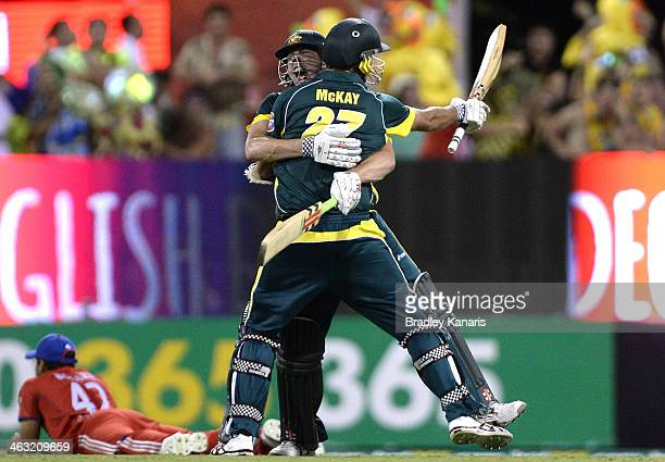 James Faulkner and Clint McKay of Australia celebrate victory after the second game of the One Day International Series between Australia and England...