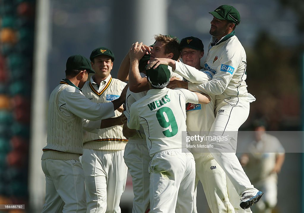 James Faulkner celebrates with teammates after taking the wicket of Joe Burns of the Bulls during day three of the Sheffield Shield final between the Tasmania Tigers and the Queensland Bulls at Blundstone Arena on March 24, 2013 in Hobart, Australia.