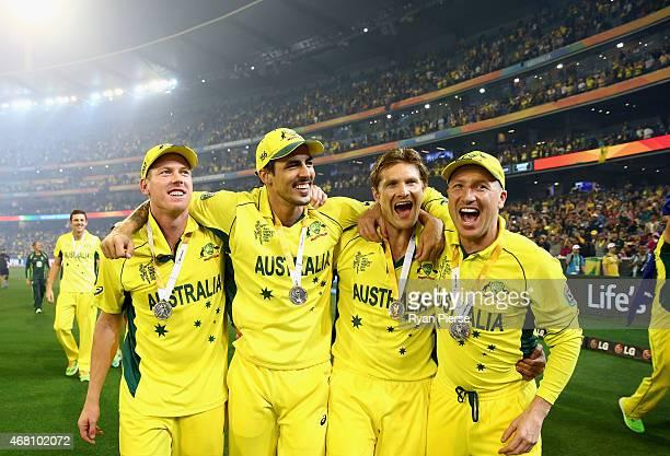 James Faulkner Mitchell Johnson Shane Watson and Brad Haddin of Australia celebrate during the 2015 ICC Cricket World Cup final match between...